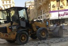 إزالة البازلت الموجود بشارع أحمد عرابي، تمهيدًا لرصف الشارع بالأسفلت - تصوير - هند الشناوي
